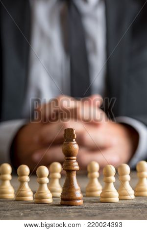 Wide Cropped View Of A Businessman Stopping Domino Effect