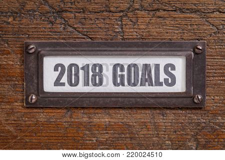 2018 goals  - a label on a grunge wooden file cabinet, New Year goals and resolutions concept