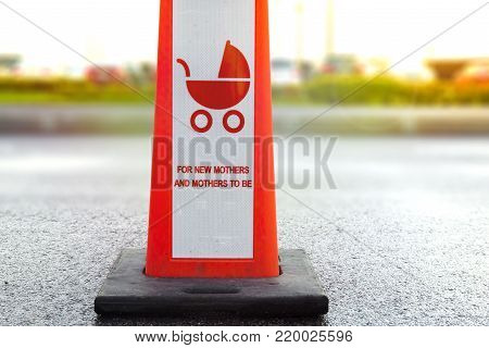 Car parking space reserved for mothers with children, sign for New Mother's and Mother's To Be