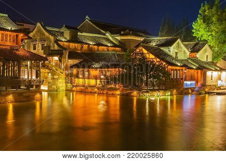 Wuzhen water village is Shanghai tourist attraction with more than 100000 visitors per year. Wuzhen is part of Tongxiang, northern Zhejiang Province, China.