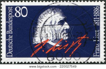 GERMANY - CIRCA 1986: A stamp printed in the Germany, dedicated to the 100th anniversary of his death Franz Liszt, portrait and signature, circa 1986