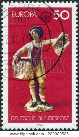 GERMANY - CIRCA 1976: A stamp printed in the Germany, shows Boy selling copperplate prints and CEPT emblem. Ludwigsburg china figurines, (1765), circa 1976