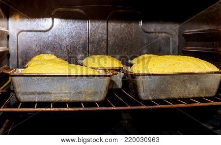 Baking bread in a professional oven in a bakery baking bread in the oven