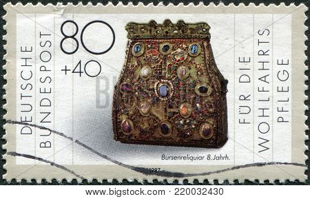 GERMANY - CIRCA 1987: A stamp printed in Germany, is shown Purseshaped reliquary, (8th century), circa 1987