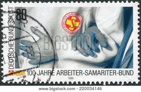 GERMANY - CIRCA 1988: A stamp printed in Germany, is dedicated to the 100th anniversary of the Samaritan Association of Workers (ASB) Rescue Service, circa 1988