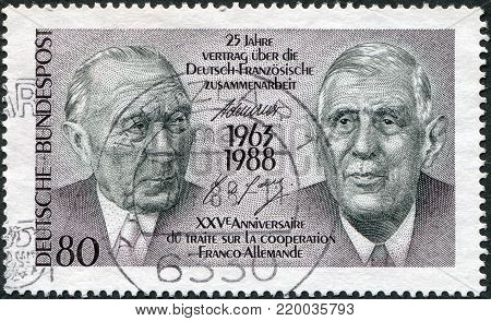 GERMANY - CIRCA 1988: A stamp printed in Germany, dedicated to 25th anniversary of the Franco-German Cooperation Treaty, shows the Konrad Adenauer and Charles de Gaulle, circa 1988