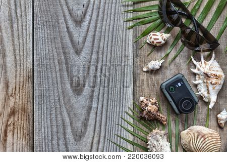 Summer vacation accessories on wooden background, holiday abroad-summer objects lifestyle in the apartment was the view from the top location
