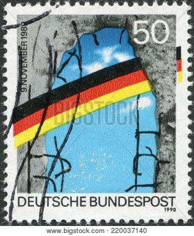 GERMANY - CIRCA 1990: A stamp printed in Germany, is dedicated to the first anniversary of the fall of the Berlin Wall, circa 1990