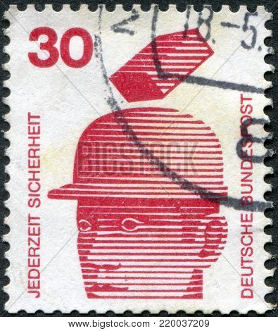 GERMANY - CIRCA 1972: A stamp printed in Germany, is dedicated to Accident prevention displayed Safety helmets prevent injury, circa 1972