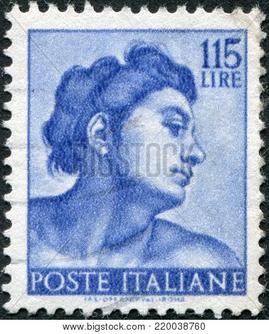 ITALY - CIRCA 1961: A stamp printed in Italy, shows Designs from Sistine Chapel by Michelangelo, Heads of various
