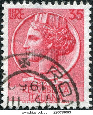 ITALY - CIRCA 1956: A stamp printed in Italy, is shown Italia Turrita after Syracusean Coin, circa 1956