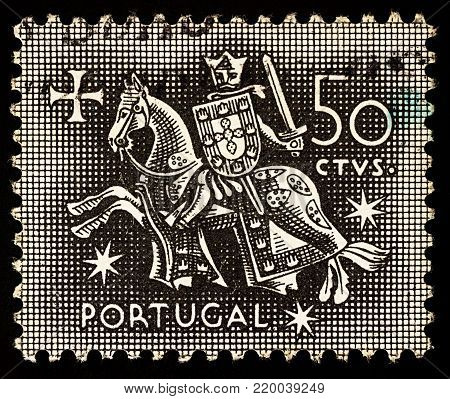 Moscow, Russia - December 27, 2017: A stamp printed in Portugal shows Knight on horseback (from the seal of King Diniz of Portugal, 1261-1325), circa 1953