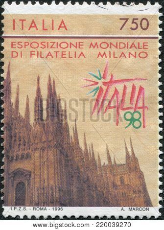 ITALY - CIRCA 1996: A stamp printed in Italy, is dedicated to the International Philatelic Exhibition, ITALIA - 98, shows the Cathedral of Milan, circa 1996