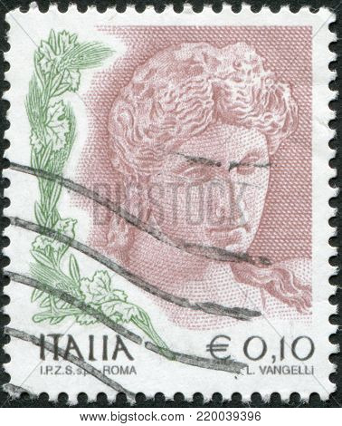 ITALY - CIRCA 2004: A stamp printed in Italy, shows the Head of terra cotta statue, 3rd century BC, circa 2004