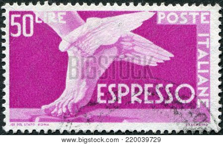 ITALY - CIRCA 1951: A stamp printed in Italy, shows a winged feet, circa 1951