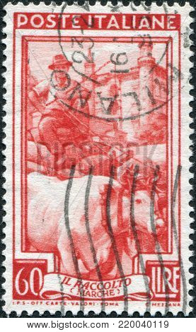ITALY - CIRCA 1950: A stamp printed in Italy, shows the Grain cart, in the background, Palazzo Ducale, Urbino (Marche), circa 1950