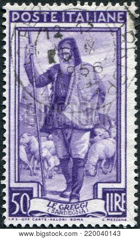 ITALY - CIRCA 1950: A stamp printed in Italy, shows the Shepherd and flock, watchtower (Sardinia), circa 1950