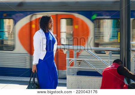 Woman in Paris on platform on railway station. Local French commuter going to work or vacation. Tourist using subway or intercity train in France. Parisian woman in a subway station. France, Paris, September, 27, 2014