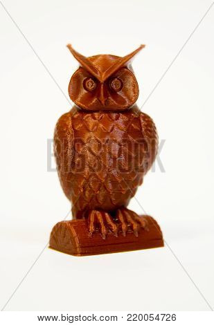 Abstract object of brown color printed by 3d printer isolated on white background. Fused deposition modeling, FDM. Progressive modern additive technology. Concept of 4.0 industrial revolution