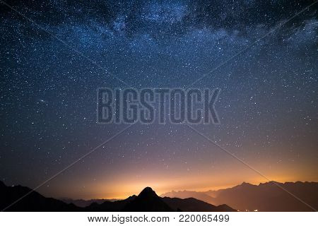 The Wonderful Starry Sky On Christmas Time And The Majestic High Mountain Range Of The Italian Alps,