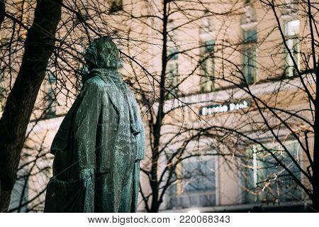 Helsinki, Finland. Evening View Of Monument To Finnish Poet And Journalist Eino Leino In Esplanade Park.