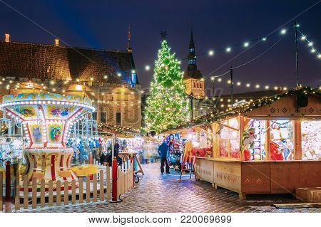 Tallinn, Estonia. Traditional Christmas Market On Town Hall Square. Christmas Tree And Trading Houses. Happy New Year Holiday.