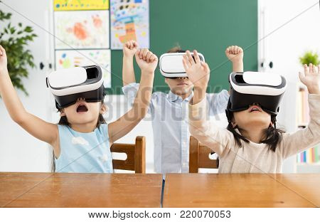 children with virtual reality headset in classroom