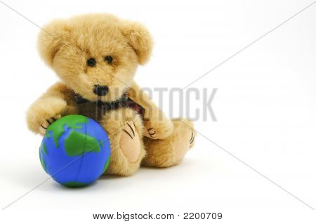 Small teddy bear holding a small globe poster
