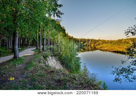 High Water Level In River Gauja, Near Valmiera City In Latvia. Summer Trees Surrounding