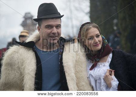 Barsana, Maramuresh/Romania - 12.25.2017: Married couple dressed in winter traditional Romanian (Maramuresh region) clothes. Outdoor scene.