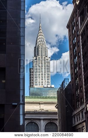 NEW YORK-JULY 22: The iconic Chrysler Building frames by surrounding buildings on a July 22 2015 in New York City.