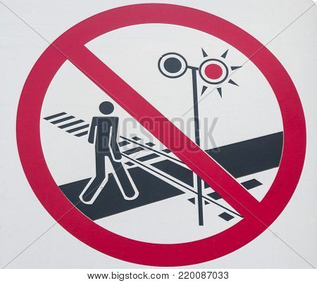 Sign prohibiting goes over the railroad tracks triggering the alarm.