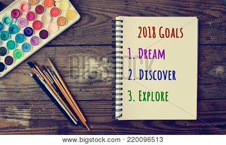 2018 Goals of dream, discover, explore on notepad