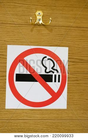 Do not smoking sign. Is depicted on a wooden wall.