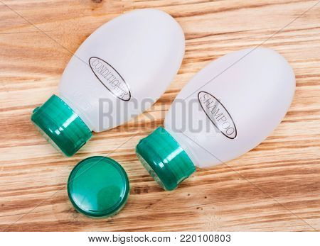 Travel size small plastic with green lids containers