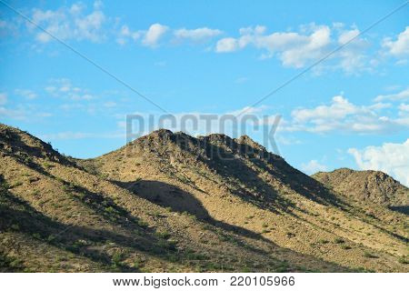 Morning view of the Sonoran Desert with sunlight on the mountain sides.