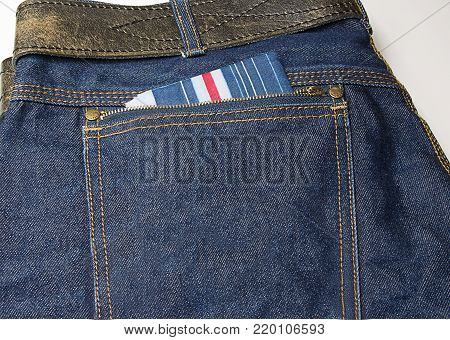 handkerchief lies in the back pocket of jeans