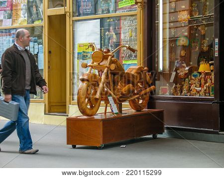 VIENNA, AUSTRIA - OCTOBER 15, 2005: Wooden motorbike located at toys shop to attract buyers in Vienna on October 15, 2005.