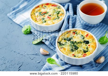 Spinach Red Bell Pepper Baked Omelet on a stone background
