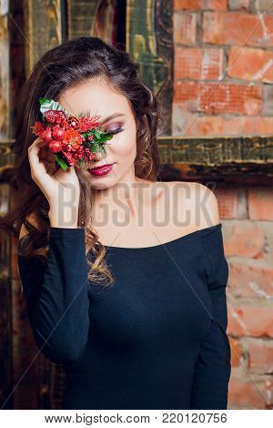 portrait of beautiful brunette woman holding in her hands bouquet of wild flowers. Enjoying sun. Happiness and love concept. Beautiful flowers. Romantic mood. Sunny day on the nature