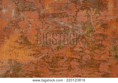Corroded red metal background. Rusty red painted metal walls. The rust spots, texture