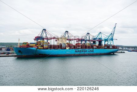 GOTHENBURG, SWEDEN - MAY 16, 2017: The large container ship Marie Maersk is docked near cranes in Gothenburg harbor.