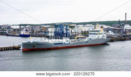 GOTHENBURG, SWEDEN - MAY 16, 2017: The tanker ship Ternsund is docked near storage tanks in Gothenburg harbor.