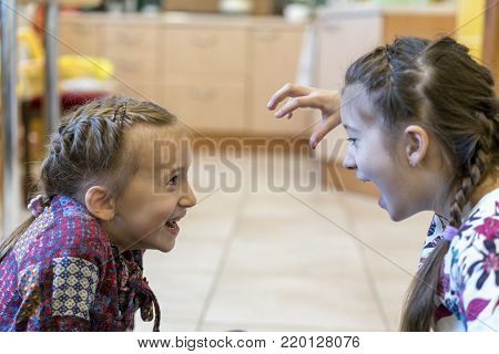 Stock photo: an image of two girls fighting and shouting