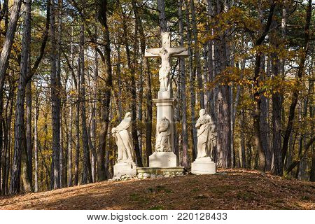 The Crucifixion of Jesus Christ sculpture group surrounded by trees