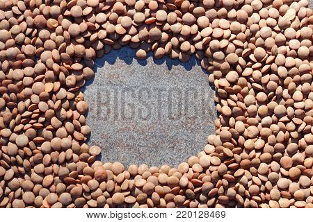 Top down view of brown lentils or Masoor dal background