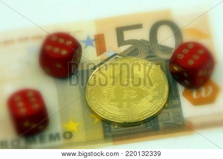 Golden physical Bitcoin cryptocurrency and 3 pairs with 6 dice symbolizing the concept gambling and winning by investing in cryptocurrencies, against a 50 Euro banknote (selective focus).