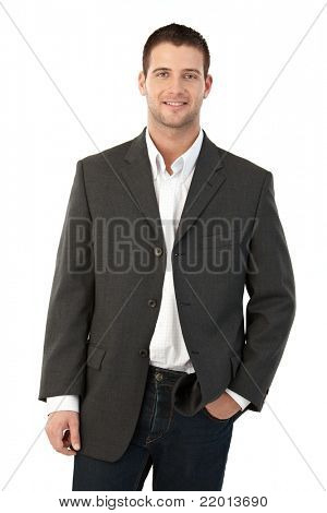 Young man smiling, hand in pocket.?