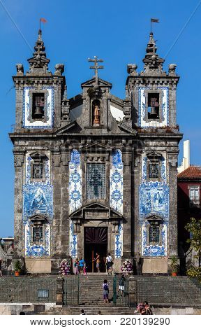 Porto, Portugal, August 16, 2017:  Facade of the 18th century church of Saint Ildefonso in Porto, Portugal, built in a proto-Baroque style, named in honor of the Visigoth, Ildephonsus of Toledo.