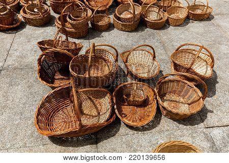 Straw baskets on sale in Porto, Portugal